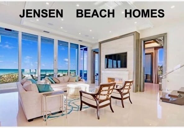 Picture of the inside of a condo from the living room with glass sliding doors looking out toward the ocean